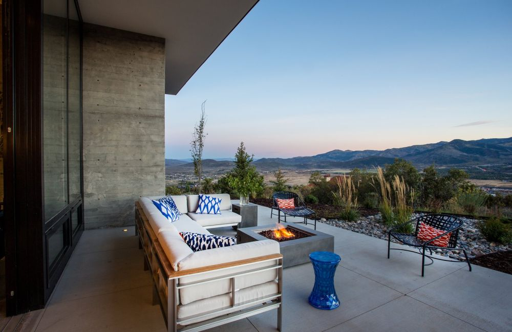 The outdoor deck is a beautiful extension of the living room and reveals a gorgeous view
