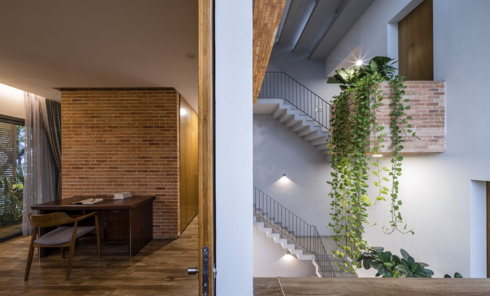 The red bricks also make an appearance inside in the form of beautiful accent walls and little decorations