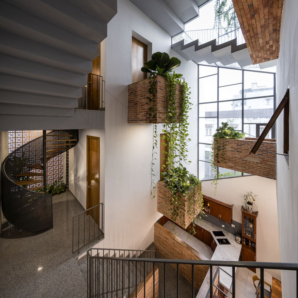 There's big hanging planters up on the walls, cascading over the staircases
