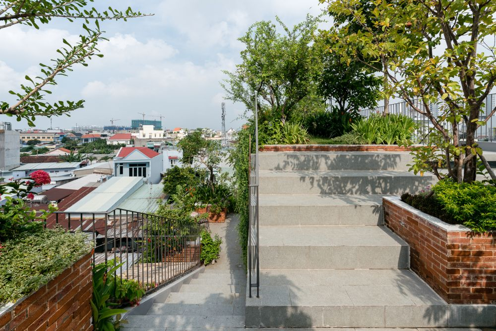These concrete stairs connect the balconies and rooftop garden areas