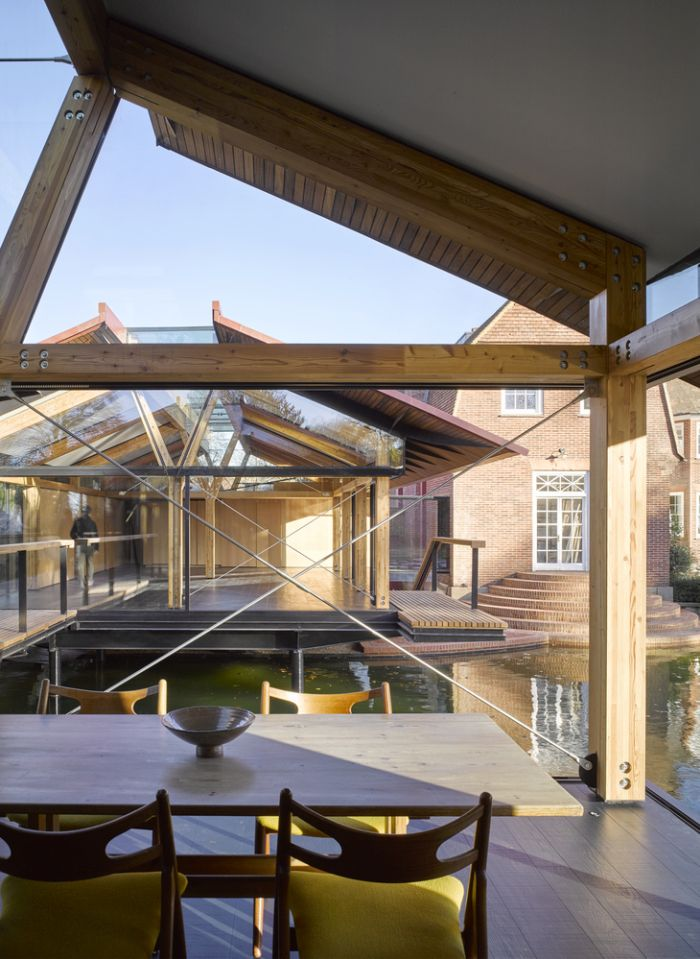 The two new houses have a clear view of each other through the full-height windows