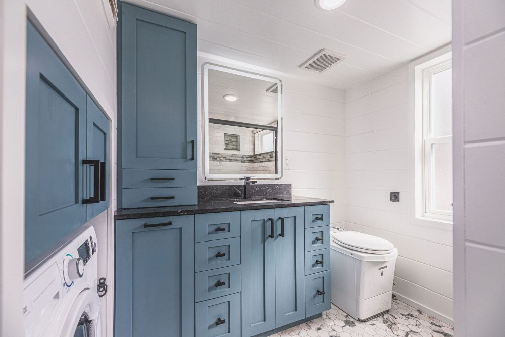 The bathroom is hidden away from all the other spaces and is pretty big for a tiny house like this one