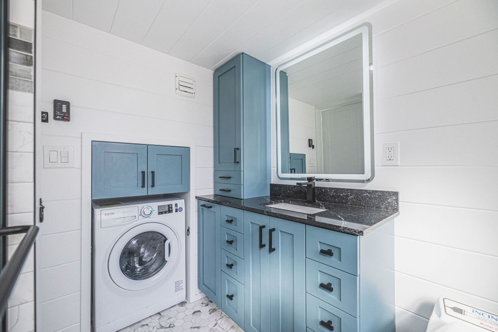 This also serves as a laundry room and the cabinetry has the same beautiful color as the kitchen