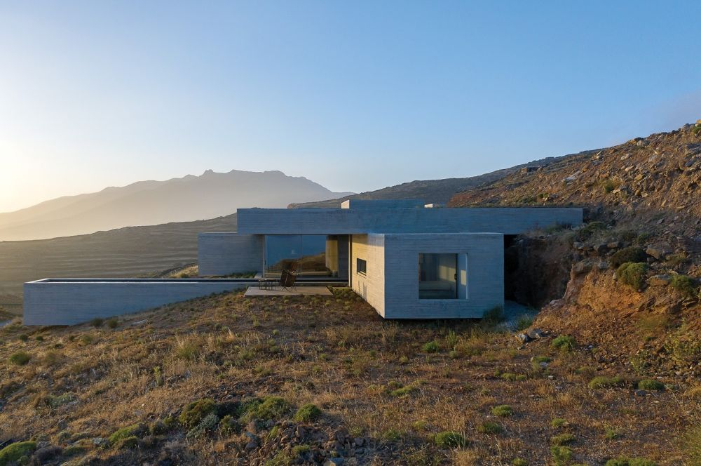 The house is blending in with the terrain which is partially covering it in a natural and organic way