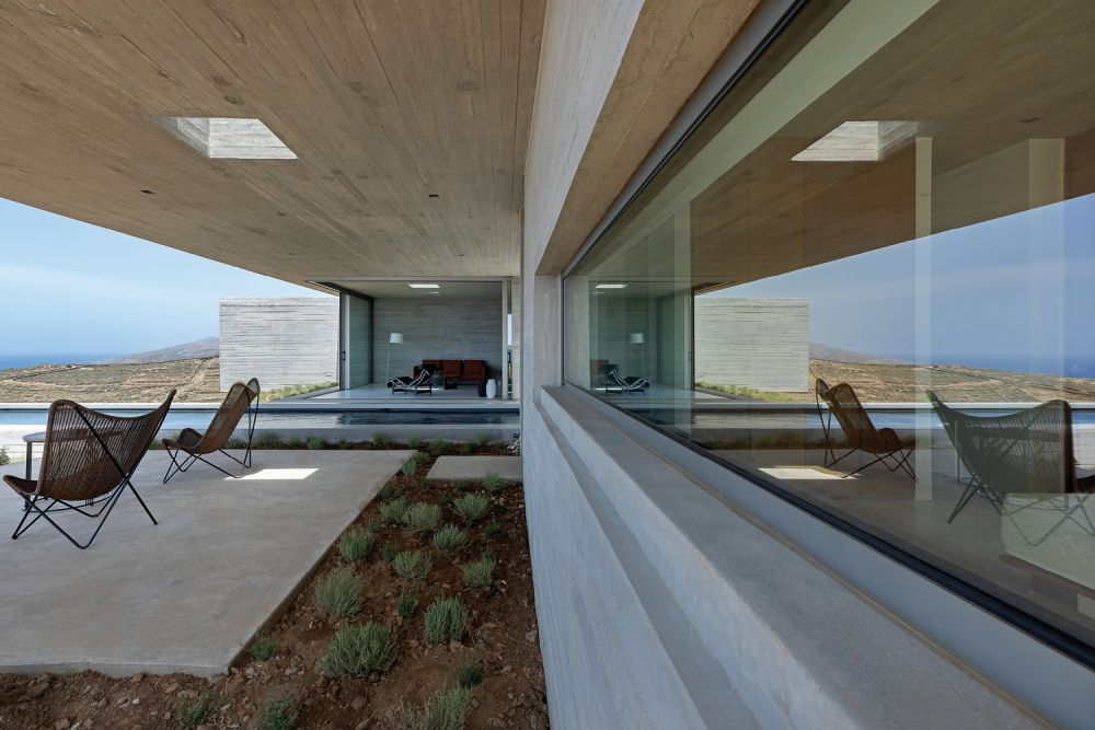 The living area which is at the center opens onto a covered terrace with a beautiful view of the surroundings
