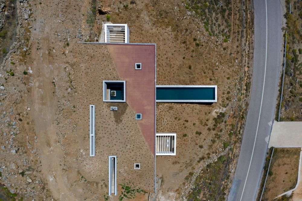 A view from above reveals the strategically-placed openings in the roof which bring natural light into all the different volumes