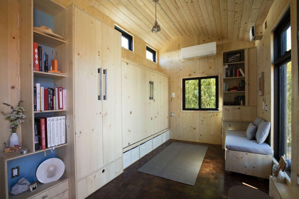 There's also a smaller fold-down sofa on the opposite wall which makes a perfect reading nook