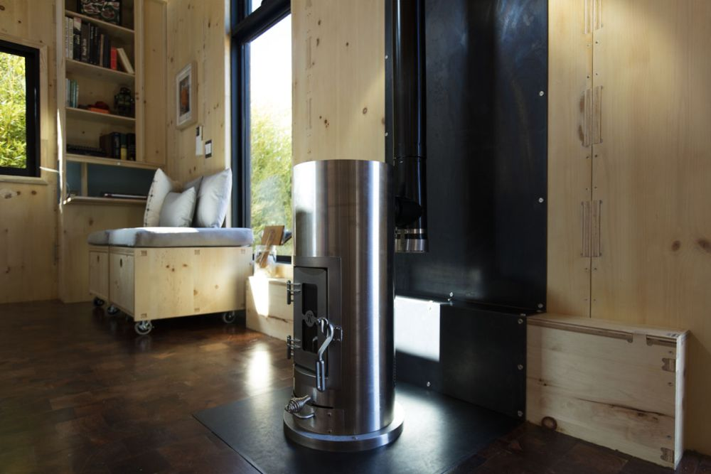 Inside a wood-burning stove and a mini-split heating and cooling system keep the house comfortable