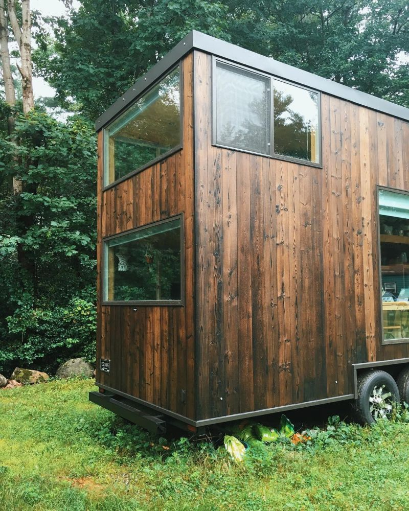 The dark cedar siding adds an elegant and homely touch to the overall design of this tiny house