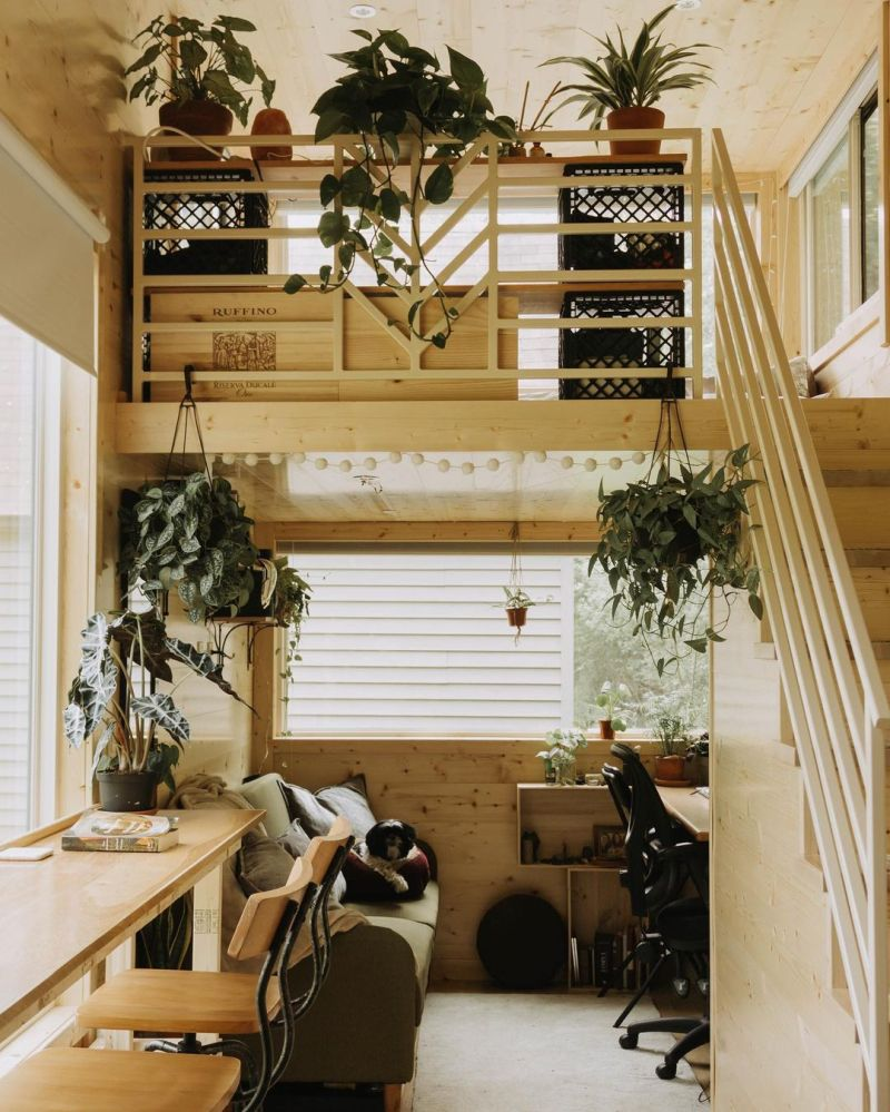 The area underneath the loft has a corner desk and a cozy lounge nook