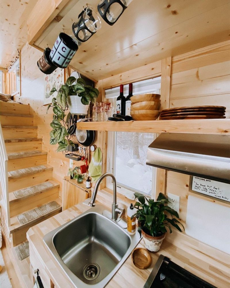 There's lots of creative storage solutions incorporated all throughout this tiny house