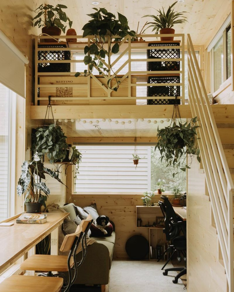 A cozy desk area takes up this side of the house and it gets plenty of natural light through the small windows