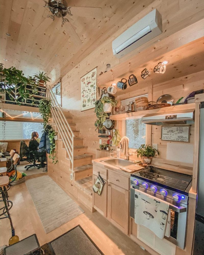 Although this tiny house is packed with furniture and decorations, it feels airy and spacious on the inside