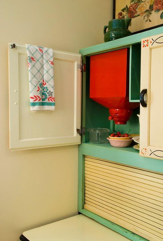 red flour sifter in hoosier cabinet