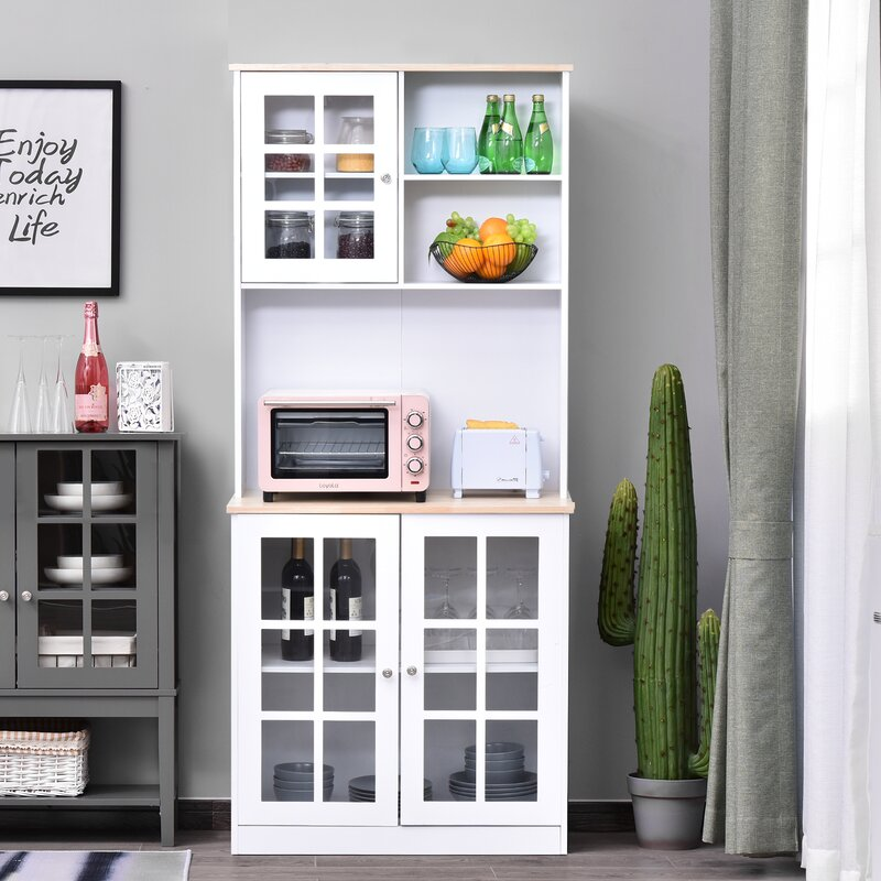 white hoosier cabinet with glass doors