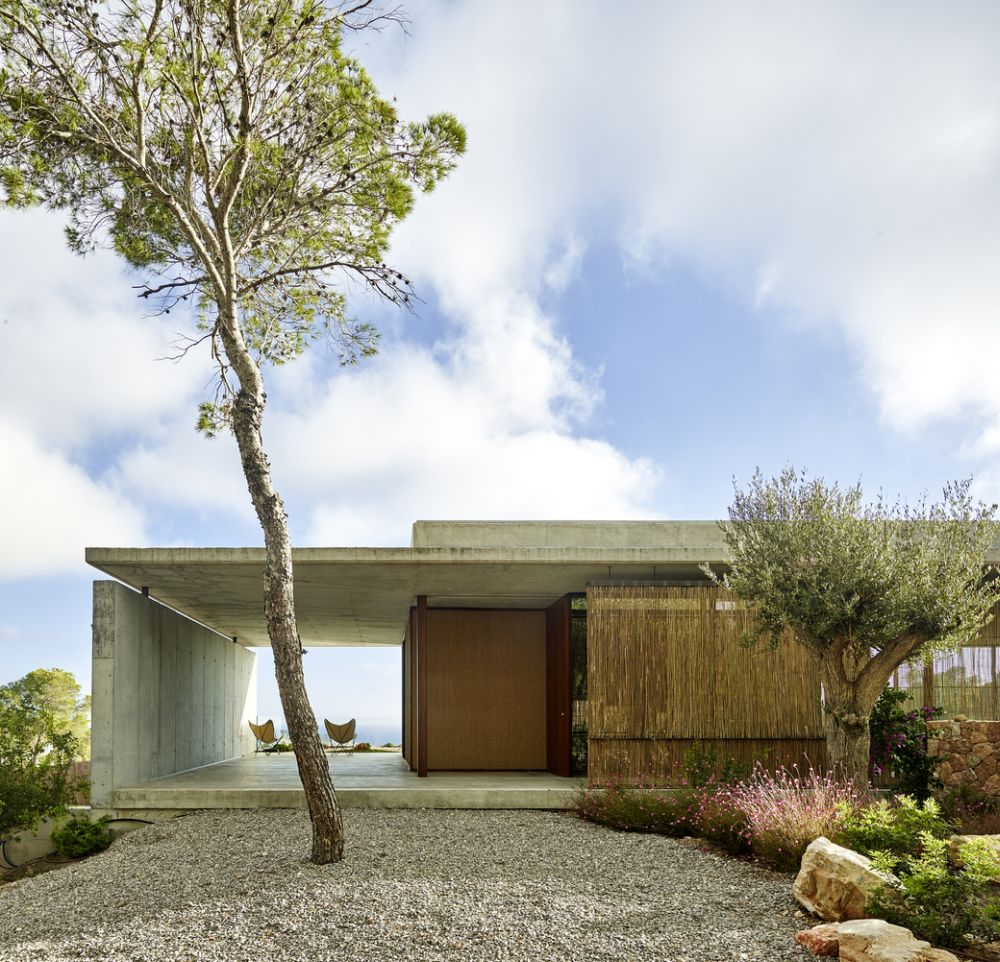 The initial concrete shell of the house has been adorned with lots of beautiful natural textures