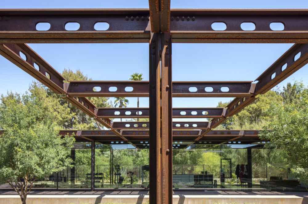 The Corten steel support pillars and beams are also extended outside where they frame some of the outdoor spaces