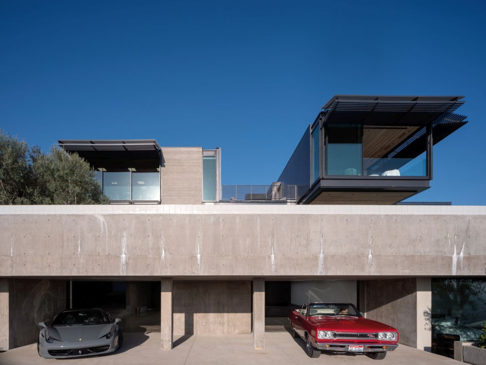 The lower level of the house is dedicated to the owner's personal interesting and includes a car gallery