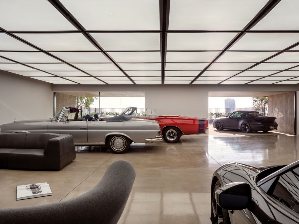 The car gallery is nicely integrated into the big and open floor plan of the lower level