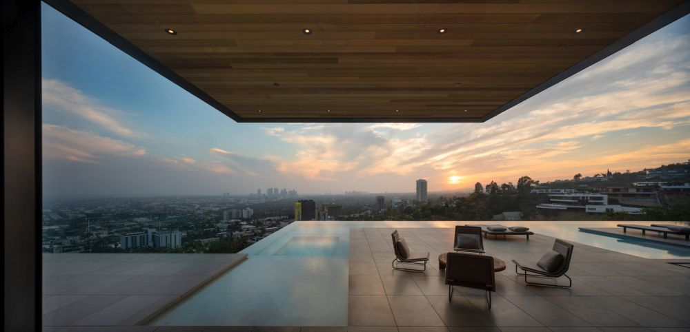 The terrace and the pool are cantilevered over the hillside
