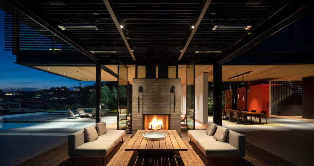 The living and dining area transition outside onto a series of terraces such as tis one