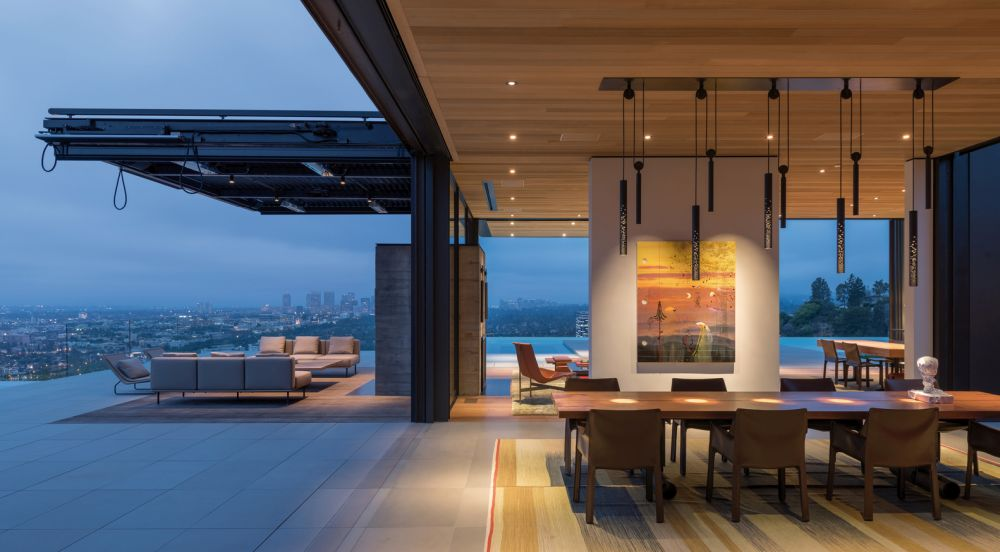 The main floor has sliding walls and pivot windows which bring the outdoors in