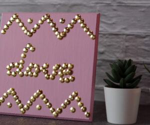 DIY Wall Art Using Thumbtacks – A Stylish Love Sign
