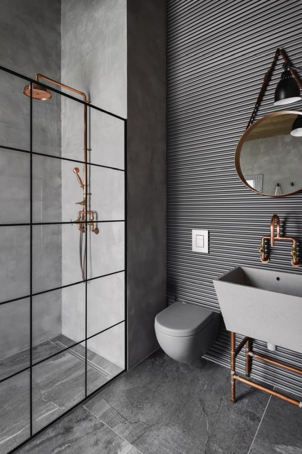 A glass shower partitions maintains a spacious vibe in the main bathroom