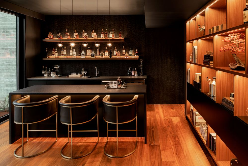 In one of the wings there's a hidden whiskey room with a small bar