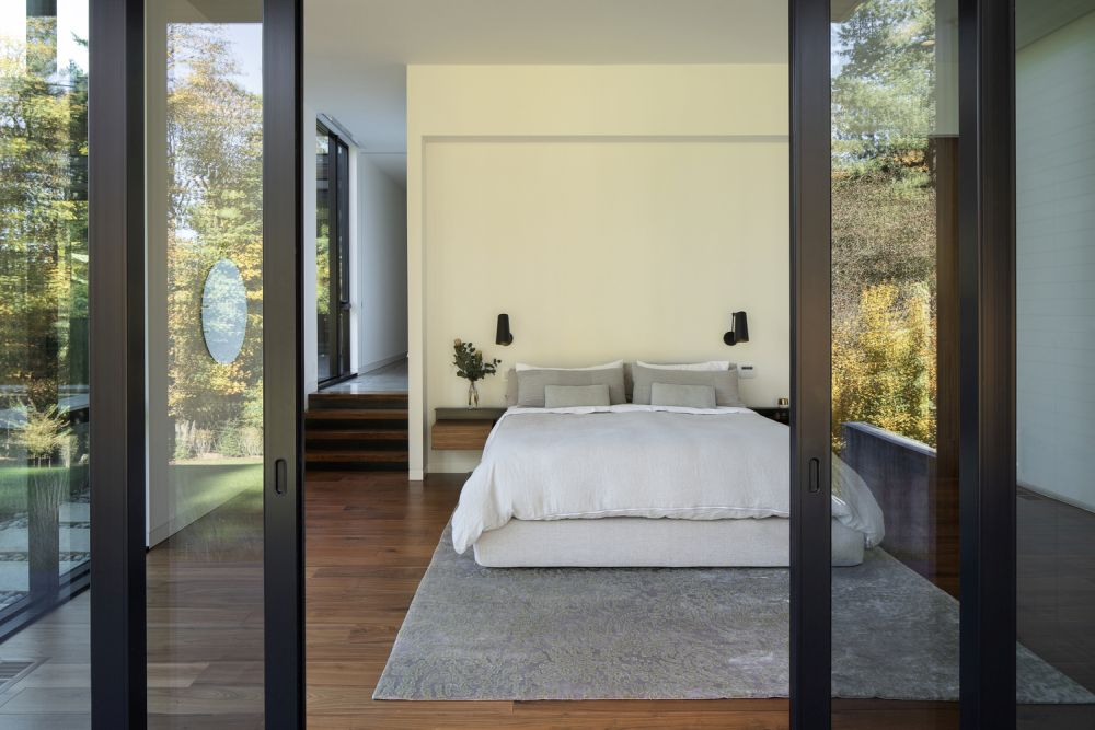 The master bedroom enjoys a sweeping view of the beautiful nearby forest
