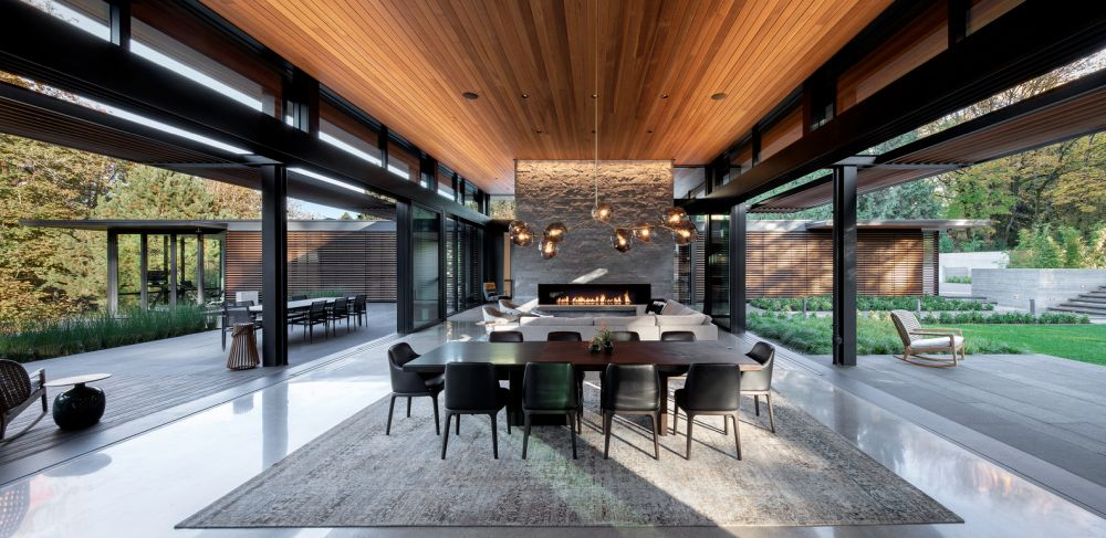 A large fireplace doubles as a space divider and adds warmth and elegance to the living and dining areas