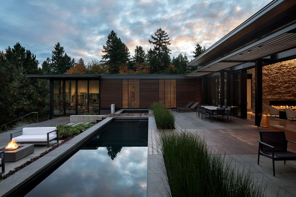 The outdoor areas follow the steep slope and form multiple levels