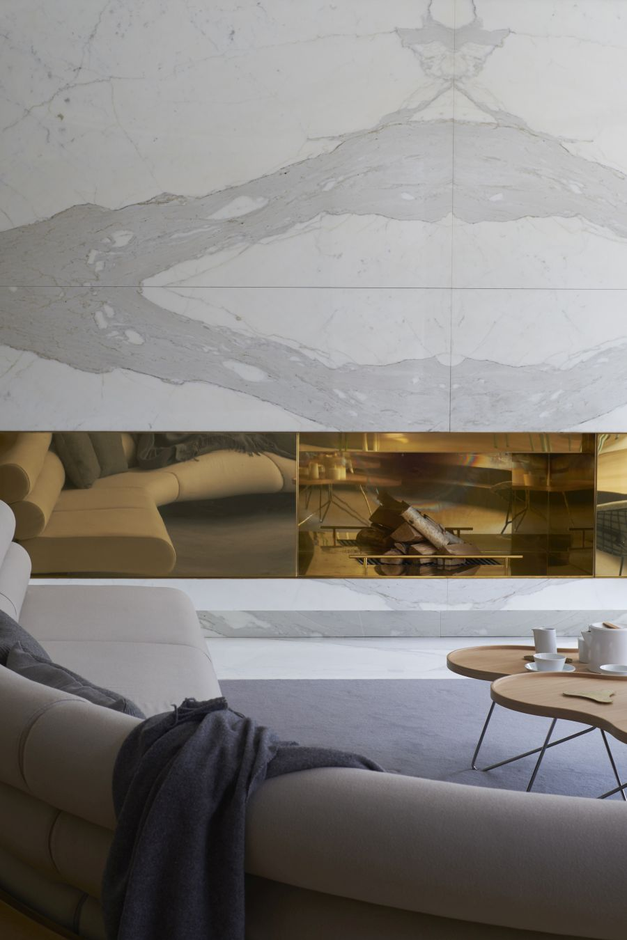 The interior design makes use of strong accent materials and puts an emphasis on texture and shape