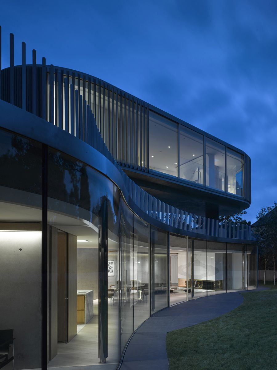 The curved glass wall links together al the the spaces on the ground floor creating a really organic layout