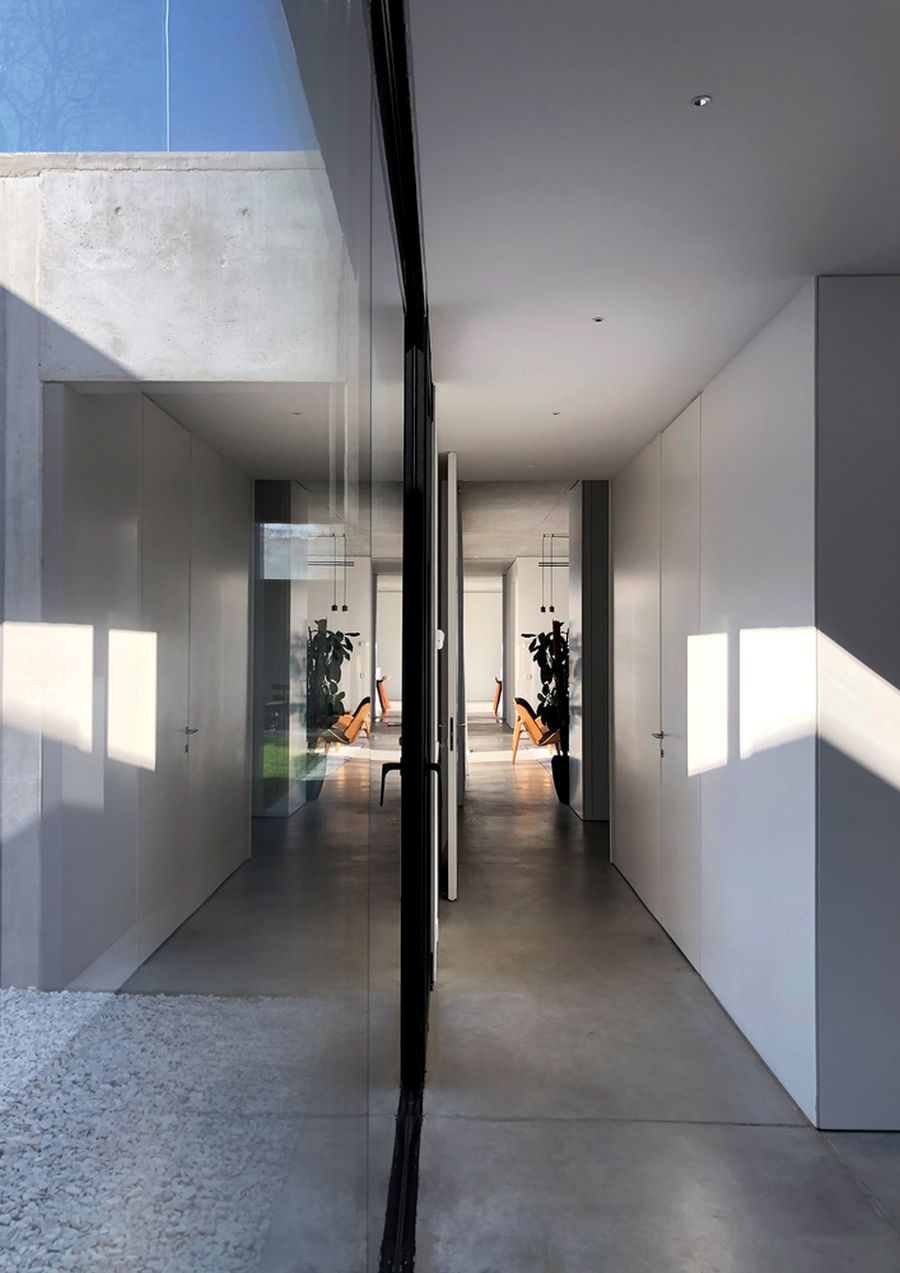 Large glass walls and openings help to bring more natural light into certain areas of the house