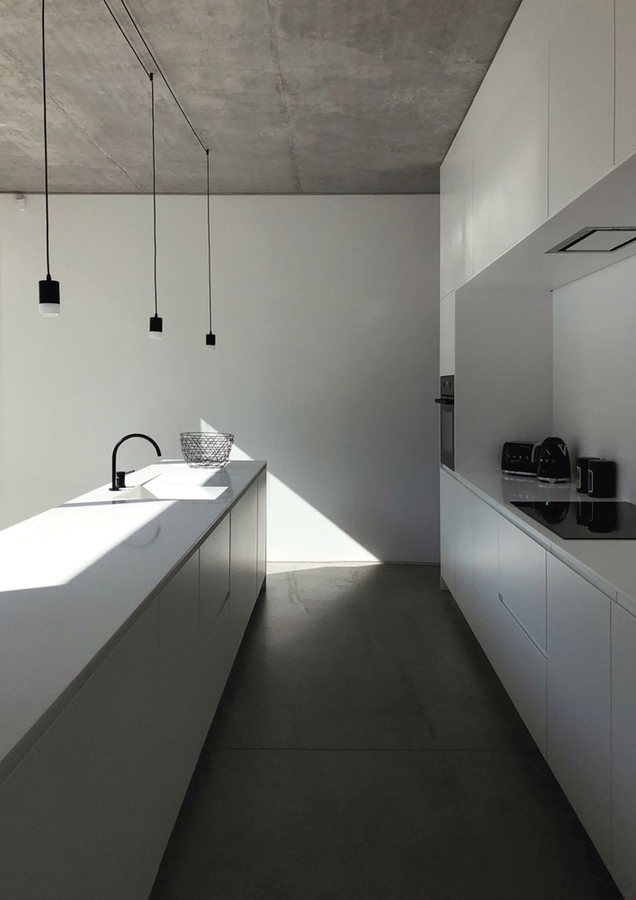 The kitchen is big and open and it's all white which gives it a bright and airy feel