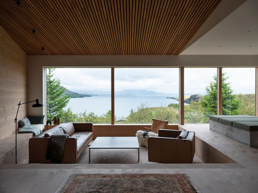 Inside, a sunken living area enjoys a great view towards the lake