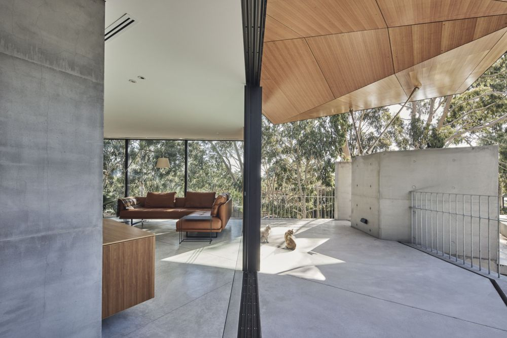 The interior living areas transition outside and have access to various covered outdoor spaces