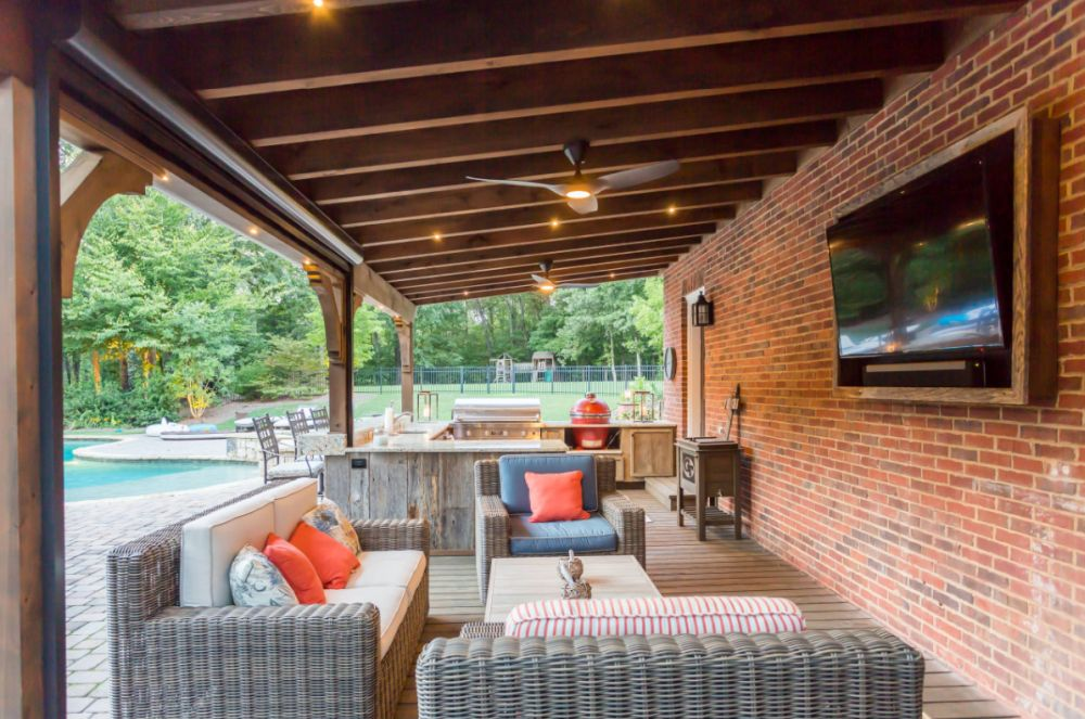 Patio Designs With TVs And Cozy Furniture