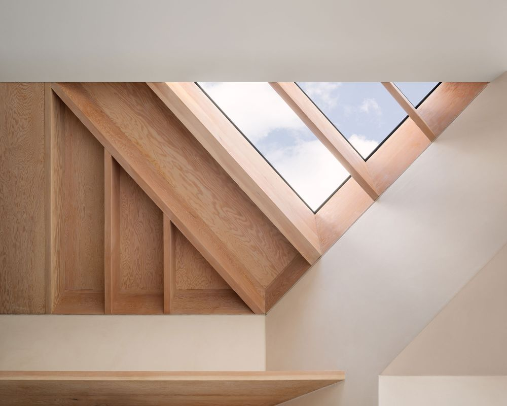 The angular quarter windows act as skylights or clerestory windows in some cases