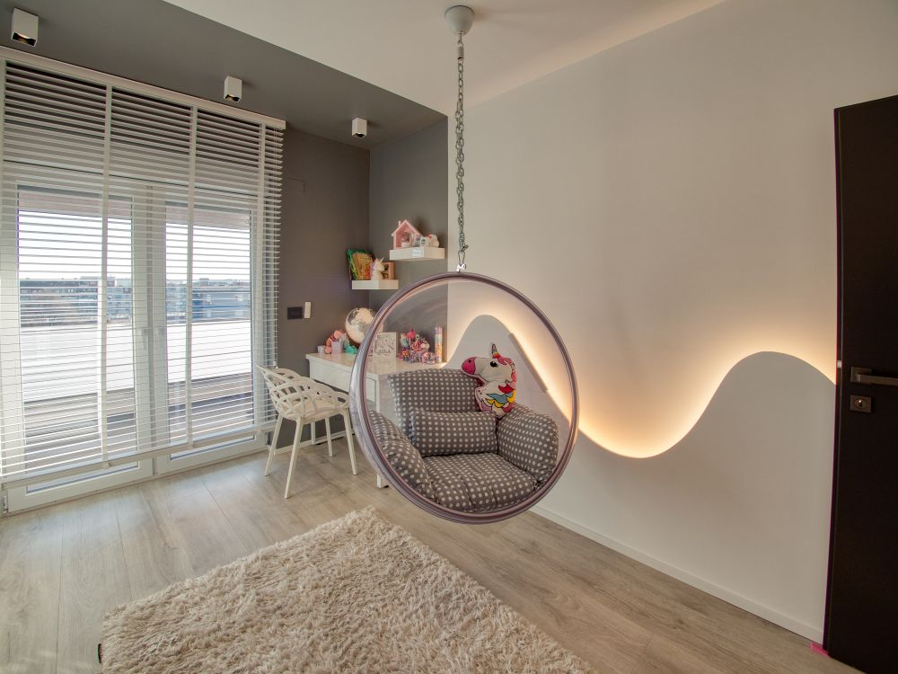 In the child's room there's a little desk area in one of the corners and a lounge chair hanging from the ceiling