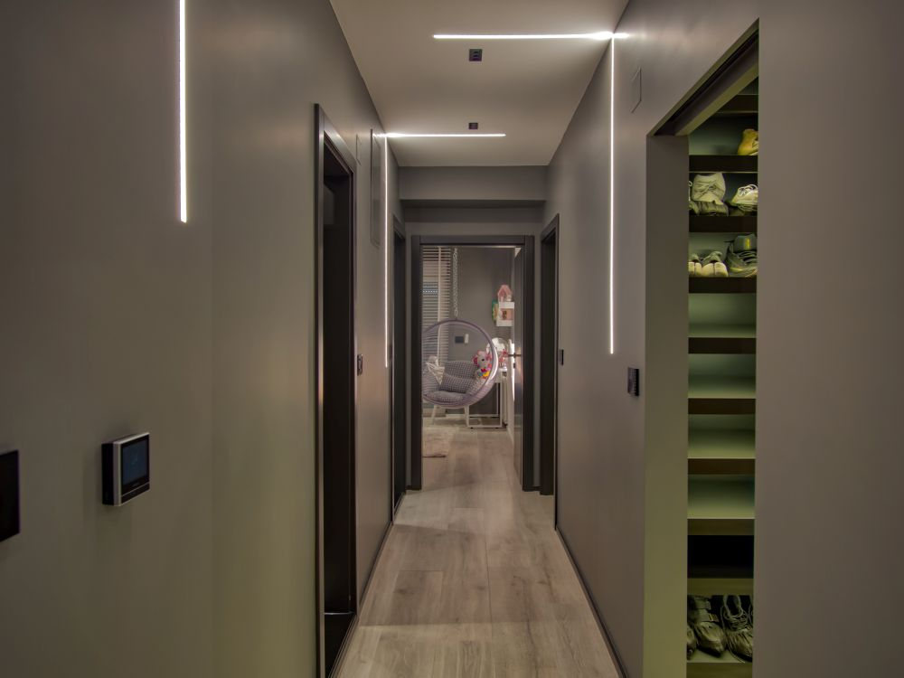 The soft grey tones are quite prominent on the hallway that connects all the rooms