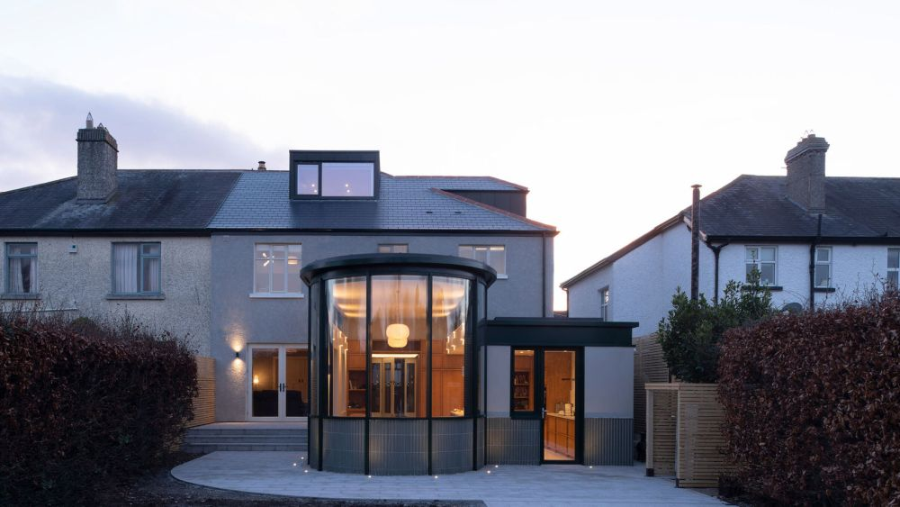 A 1930's house with a new glass extension