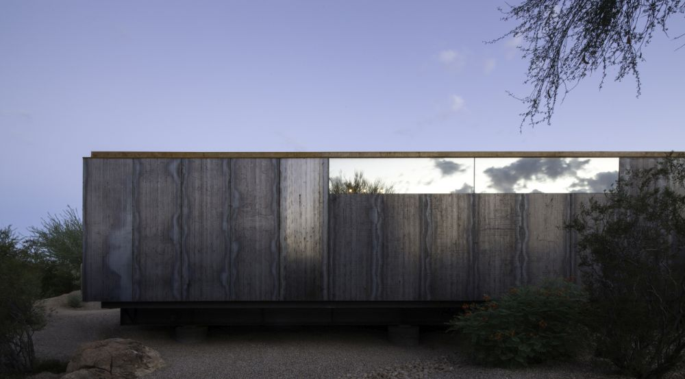 The back of the studio is mostly clad in weathering steel panels which help it blend in with the surroundings