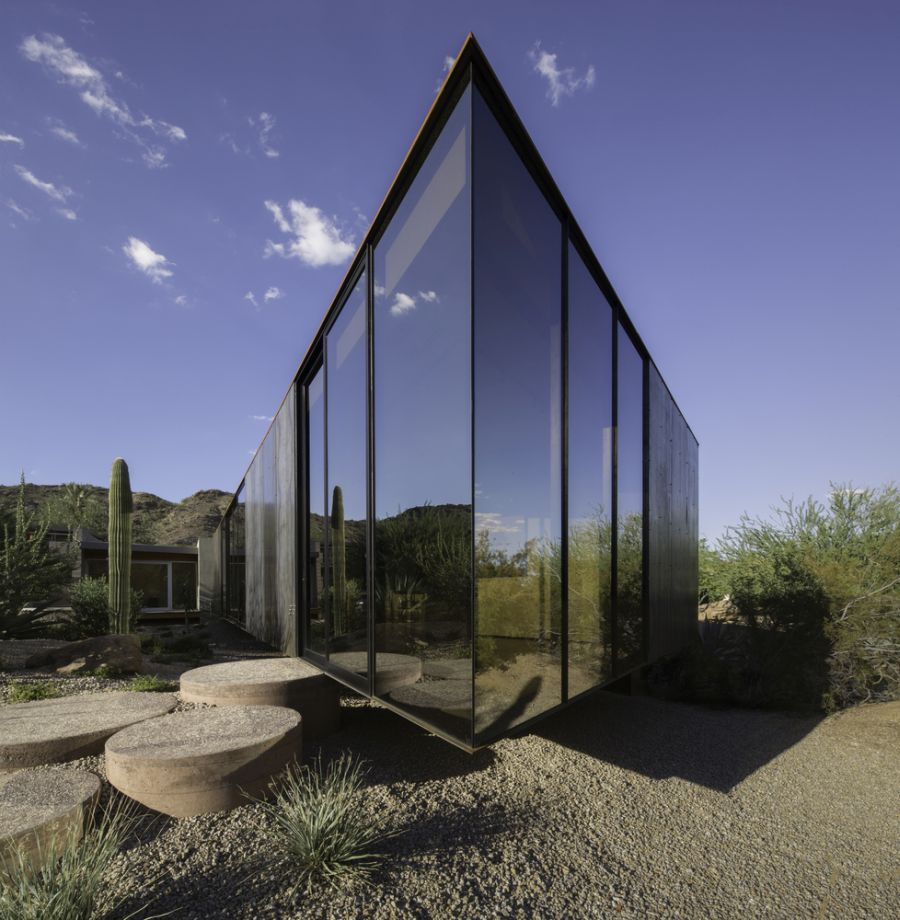 The reflective glazing puts a wonderful emphasis on the beautiful desert landscape that surrounds the studio