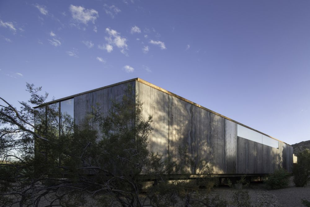 The weathering steel and reflective glass were chosen both for their unique looks and practical applications