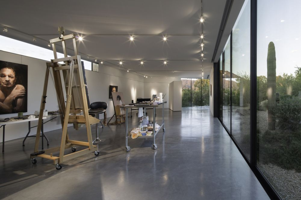 The area inside features a very simple concrete floor and a well lit white ceiling