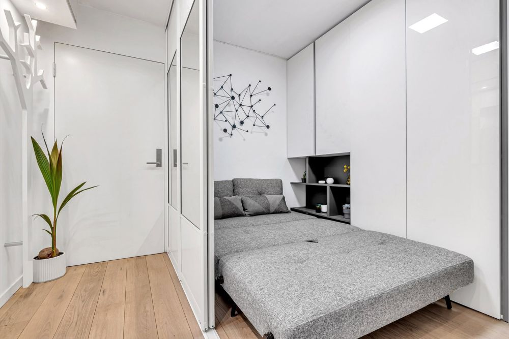 The small grey sofa can turn into a bed, transforming this into a cozy bedroom