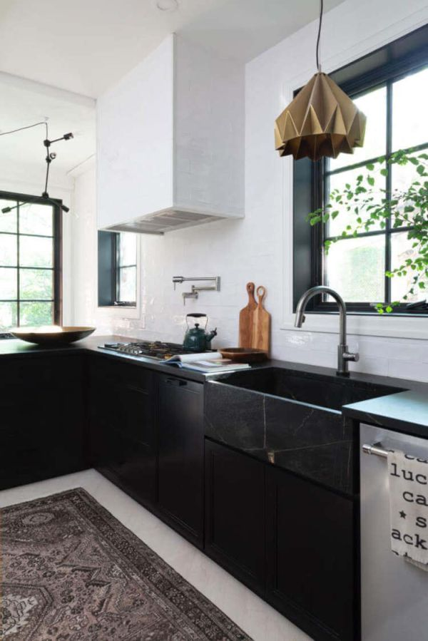 An eclectic black and white kitchen