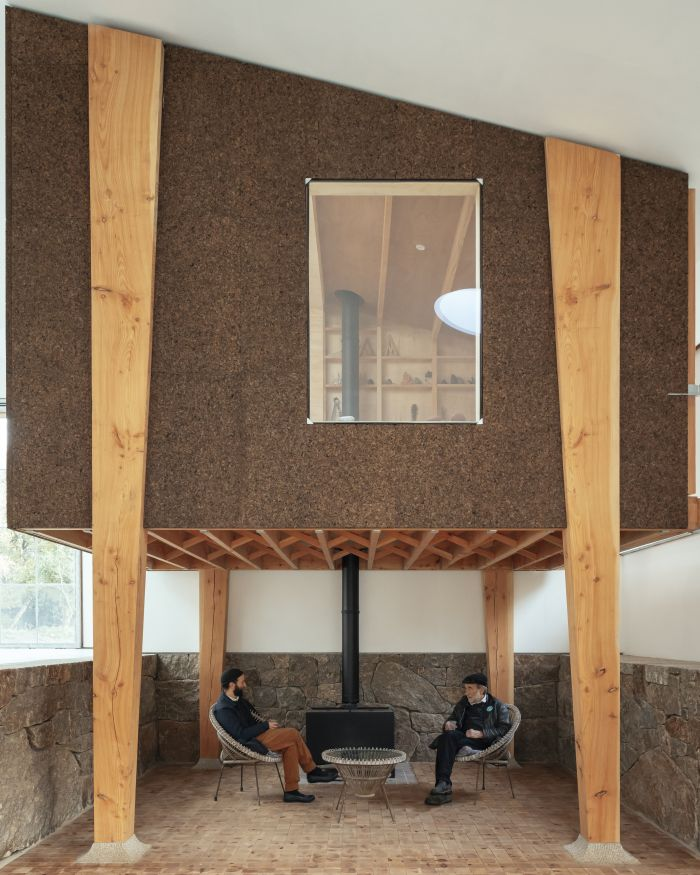 A small sunken seating area was cleverly incorporated underneath the studio